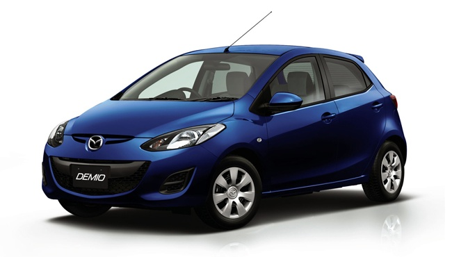 A 4-seater Mazda Demio, as available in the Pegasus Rental Cars sub-compact vehicle fleet