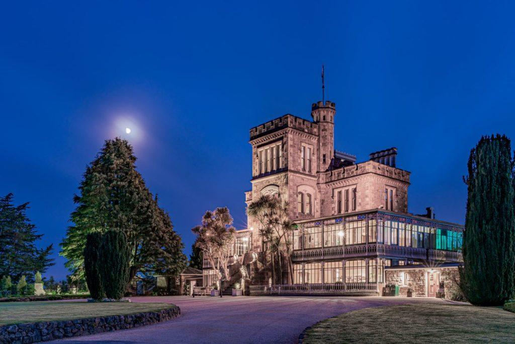 exterior view of Larnach Castle lit up at night