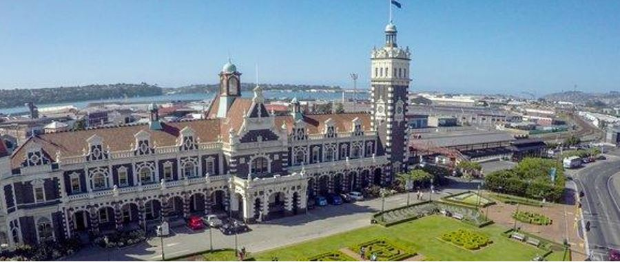 Beautiful day in with aerial view of Dunedin Railway Station in the background.
