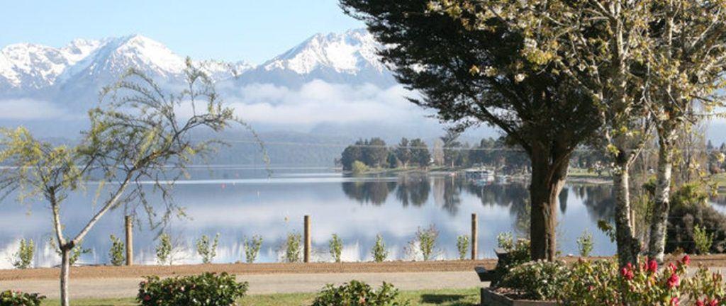 scenery of lake te anau overlooking mountains.
