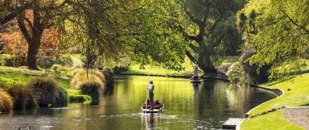 boat on a river along the Dunedin river.
