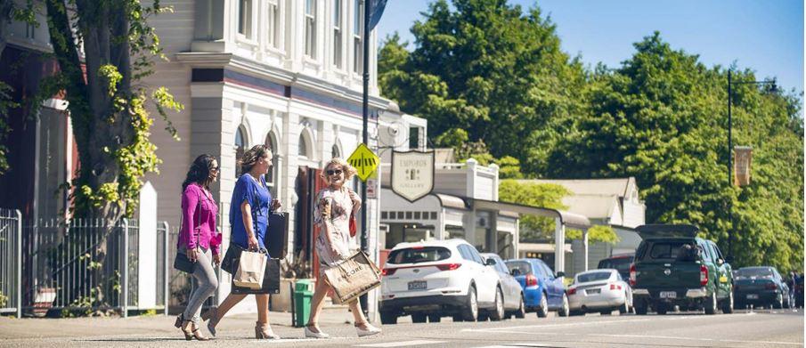 Three women outdoors on a sunny day, enjoying shopping at Greytown.