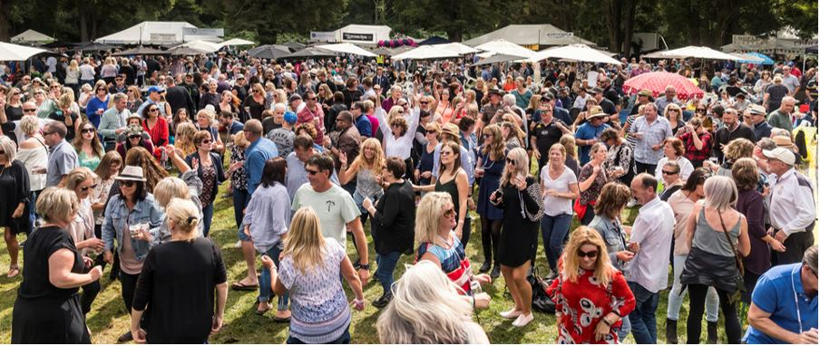 A large crowd having fun while at the Wairarapa Wine Festival.